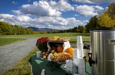 Hot cider warms guests at an early fall event at Ivey Fields