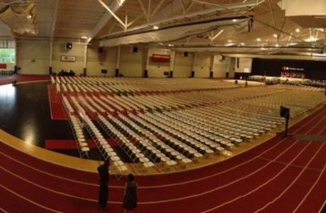 The field house set up for a Commencement ceremony.
