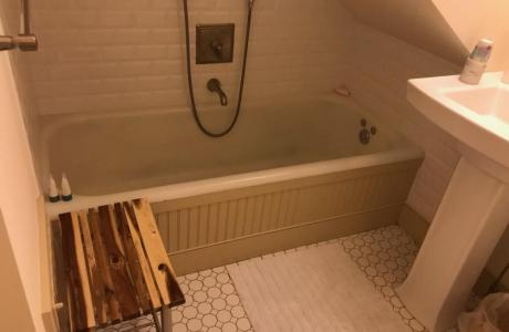 Old fashioned tub with hand held shower  on 3rd floor