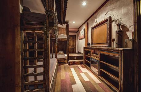 Handcrafted Dungeon Bunk Room. 8 beds: 4-Full beds / 4 Twin XL beds
