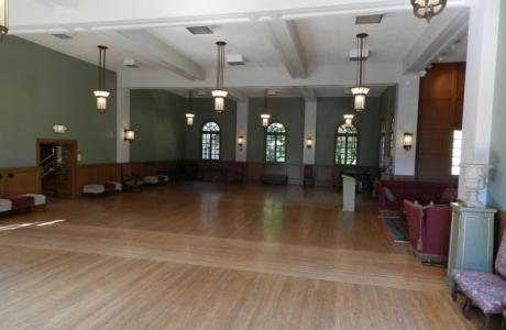 1930's ballroom with hardwood floors and fireplace