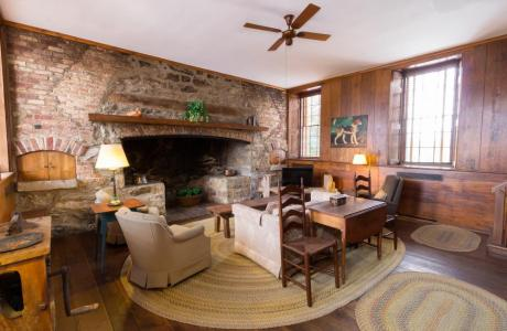 The East House living room, boasting one of the largest open hearths in VA