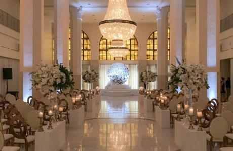 Ceremony in Whitehall Ballroom, view down aisle towards altar
