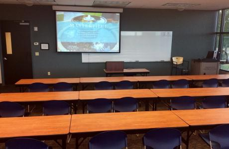Regular classroom with ceiling mounted projector displayed.