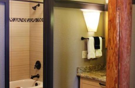 Lied Lodge newly renovated bathrooms with granite-top vanities and custom tile