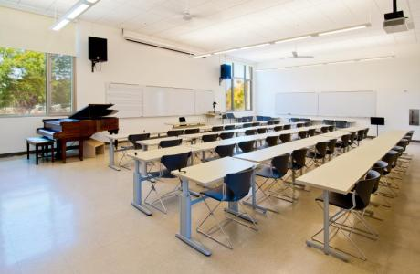 Green Music Center classroom space, with a capacity of 60, and a piano in the room, this space is ideal for music education.