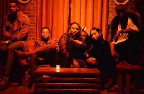 Group Photo on Iconic Velvet Couch