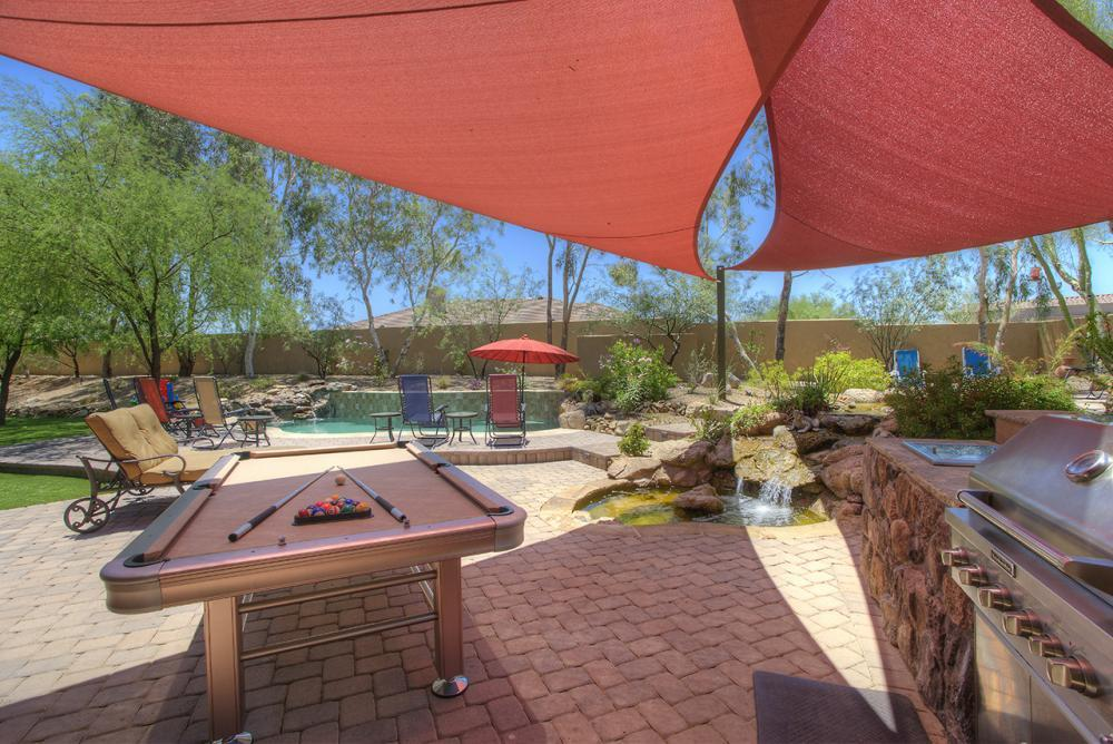 Bar-B-Q Area and Outdoor Pool Table.