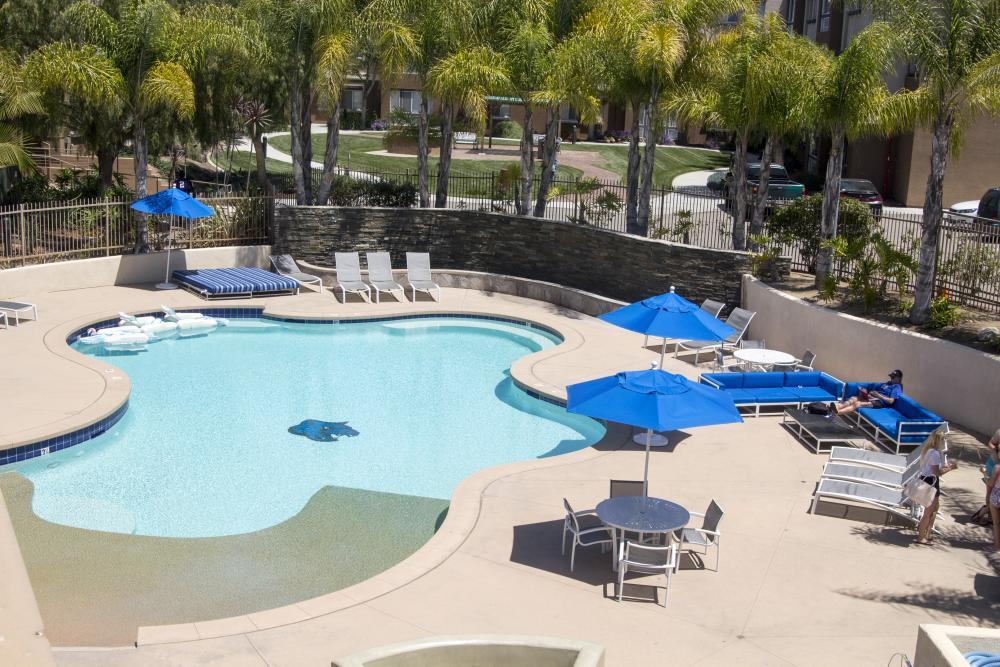 UVA Pool surrounded with lounge chairs, furniture, tables and chairs