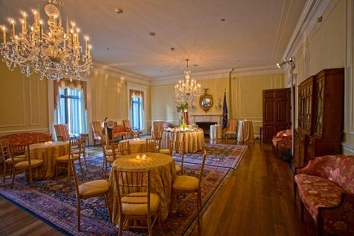 The Archivist's Reception Room, featuring large windows overlooking historic Pennsylvania Avenue and two grand chandeliers