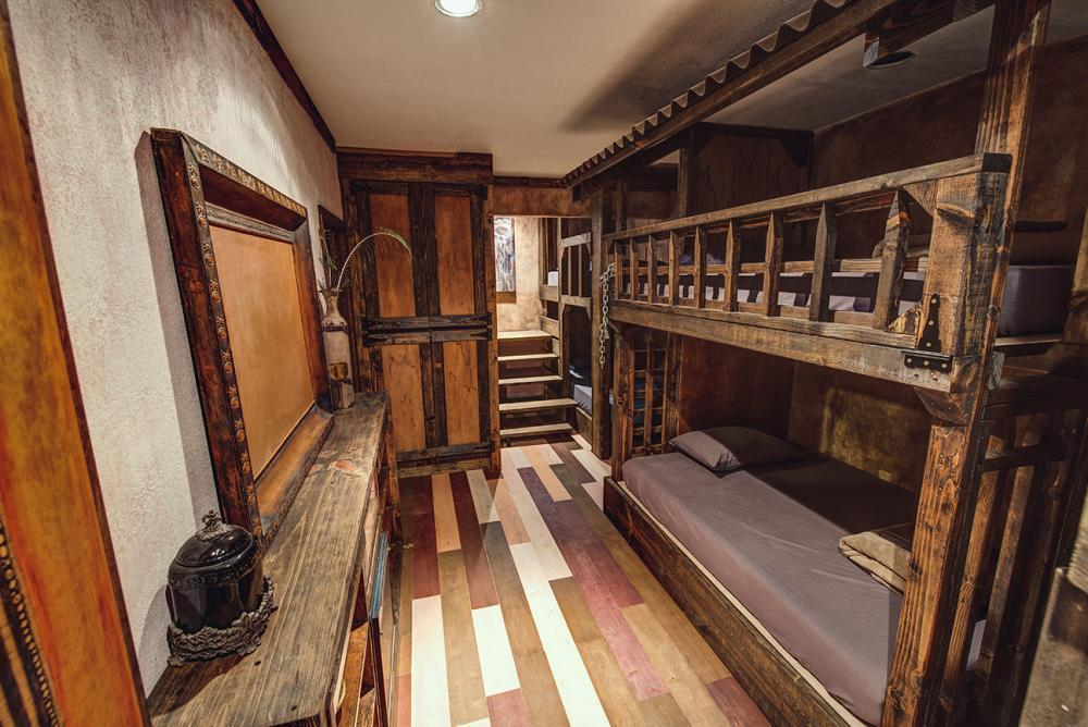 Handcrafted Dungeon Bunk Room. 8 beds: 4- Full beds / 4 Twin XL beds
