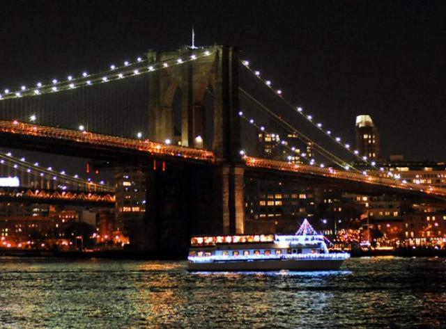 Eastern Star Yacht Sailing Under the Bridges and New York City Skyline