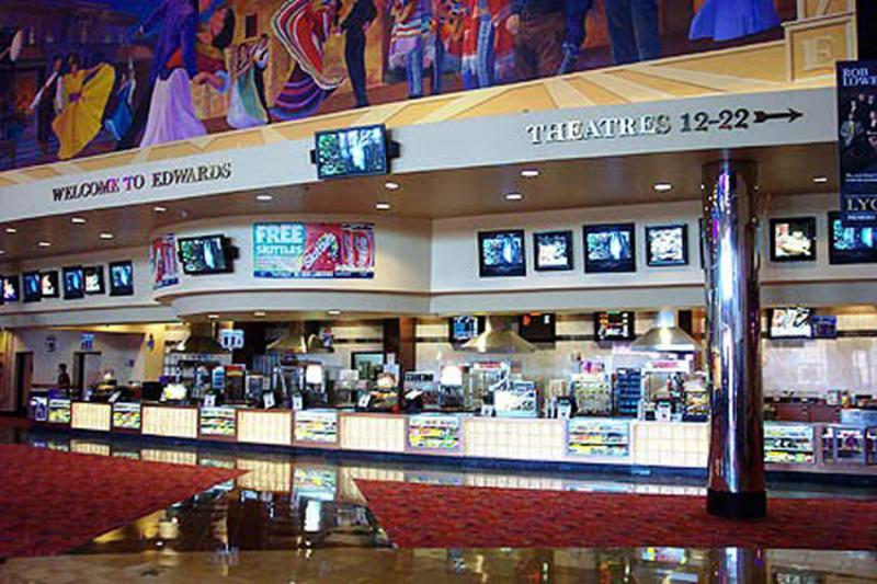 A woman was taken to a hospital after a fight in a Columbia, SC, movie theater that was prompted by another woman using her cellphone during the movie, according to a police incident report.