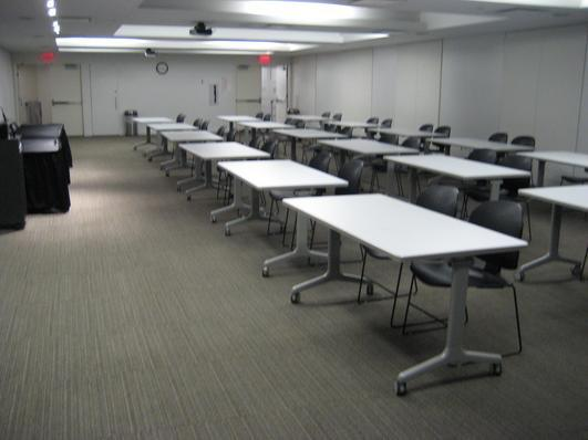 Presentation Room A (row seating with tables setup)