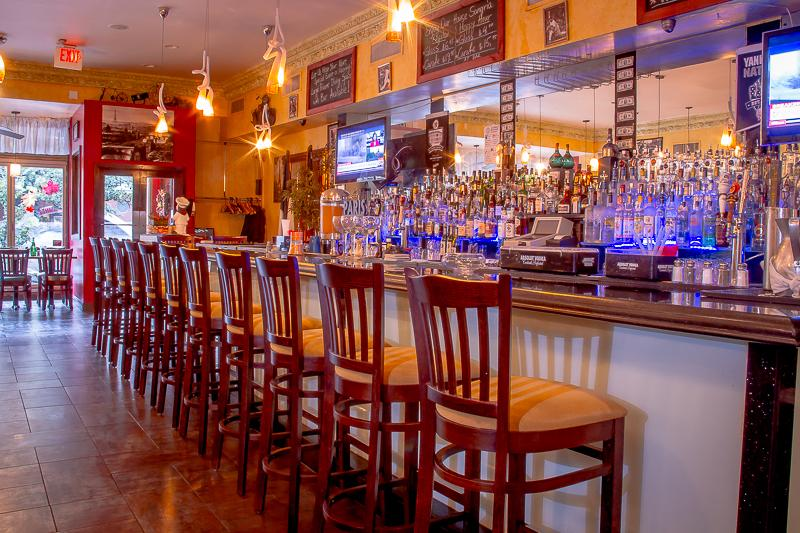 Exquisite marble-topped bar with over 100 liquors to choose from