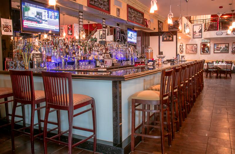 Comfortable barstool seating wraps the entire length of the bar