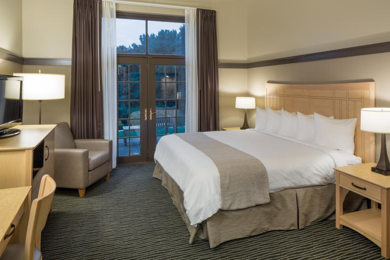 Choose from 140 guest rooms and suites with custom tile, granite-topped vanities