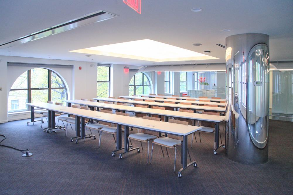 Conference Space has a movable glass wall to adjust size