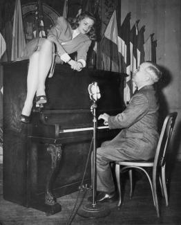 President Harry Truman sings to actress Lauren Bacall in the Press Club's Lounge