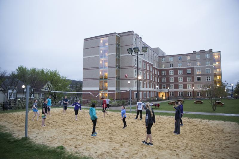 Outdoor volleyball court in the heart of the residence hall district.