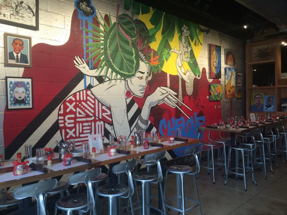 custom mural by Che Love in the bar area