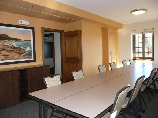 Breakout room set with tables and seating for 12
