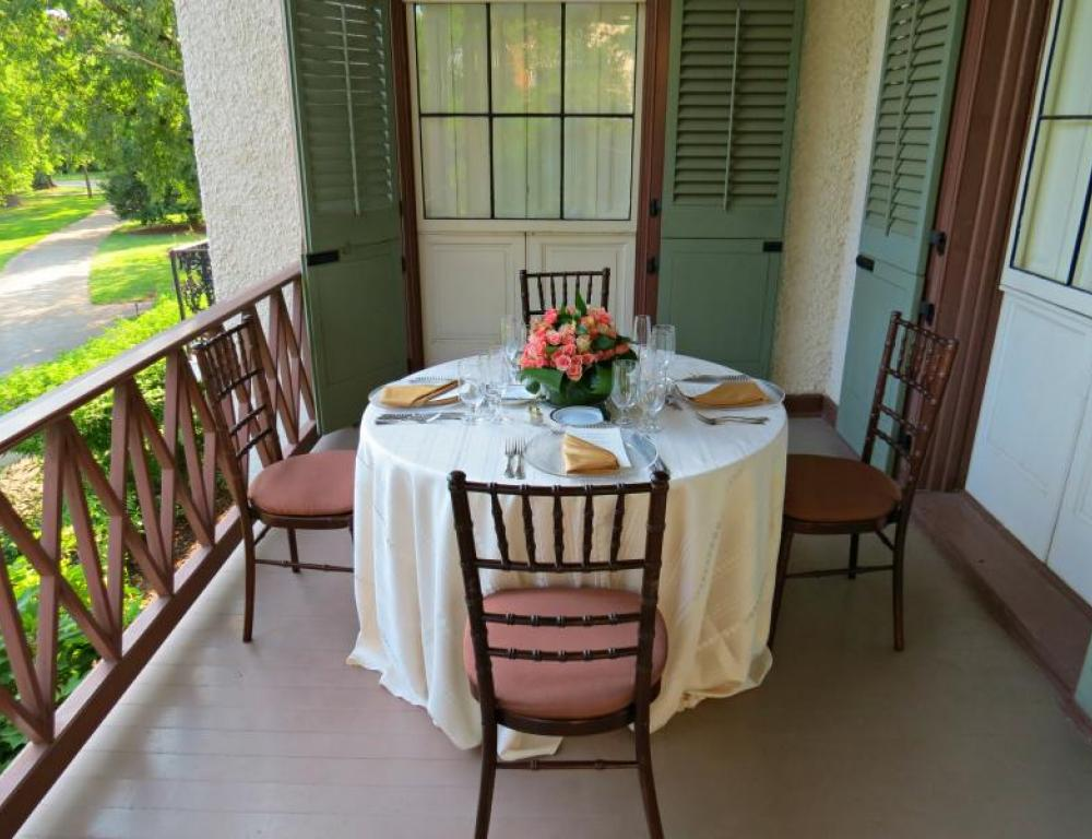 Seating on the veranda allows guests to advanatge of the beautiful landscapes of the Cottage and the Armed Forces Retirement Home.