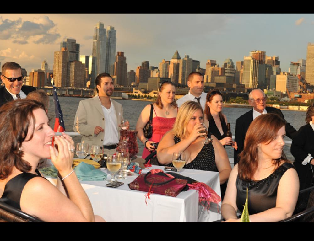 Rooftop cocktails while sightseeing and celebrating on a Hudson Harbor yacht