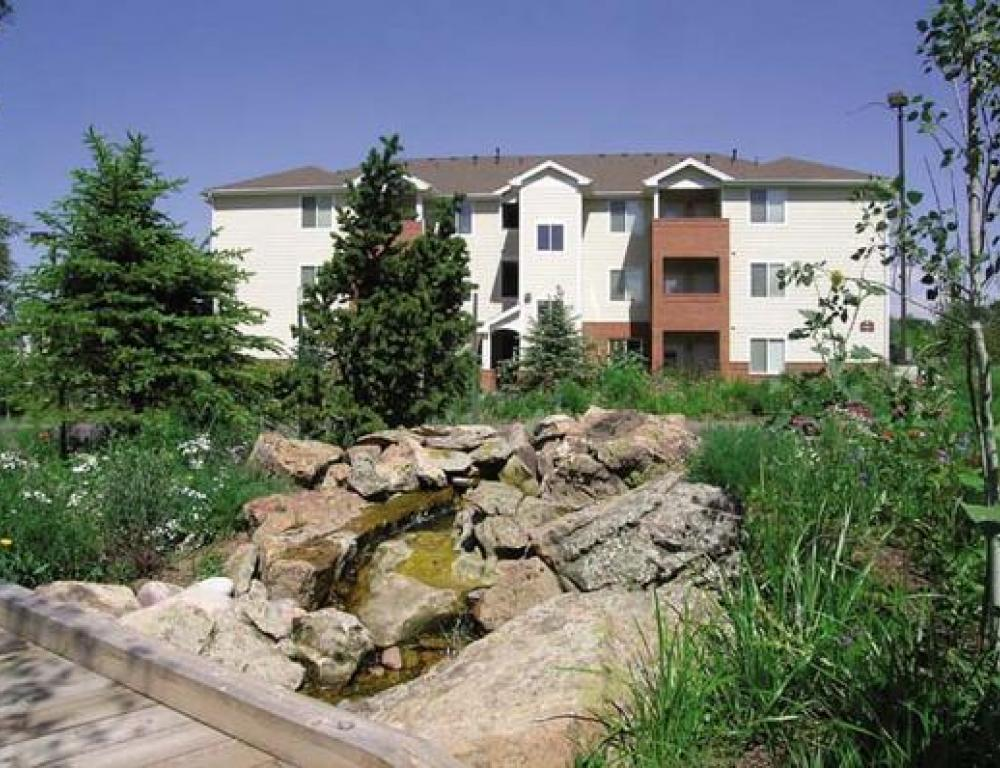 The Peaks apartments include three bedrooms, two bathrooms, a kitchen, washer, dryer, and living room.