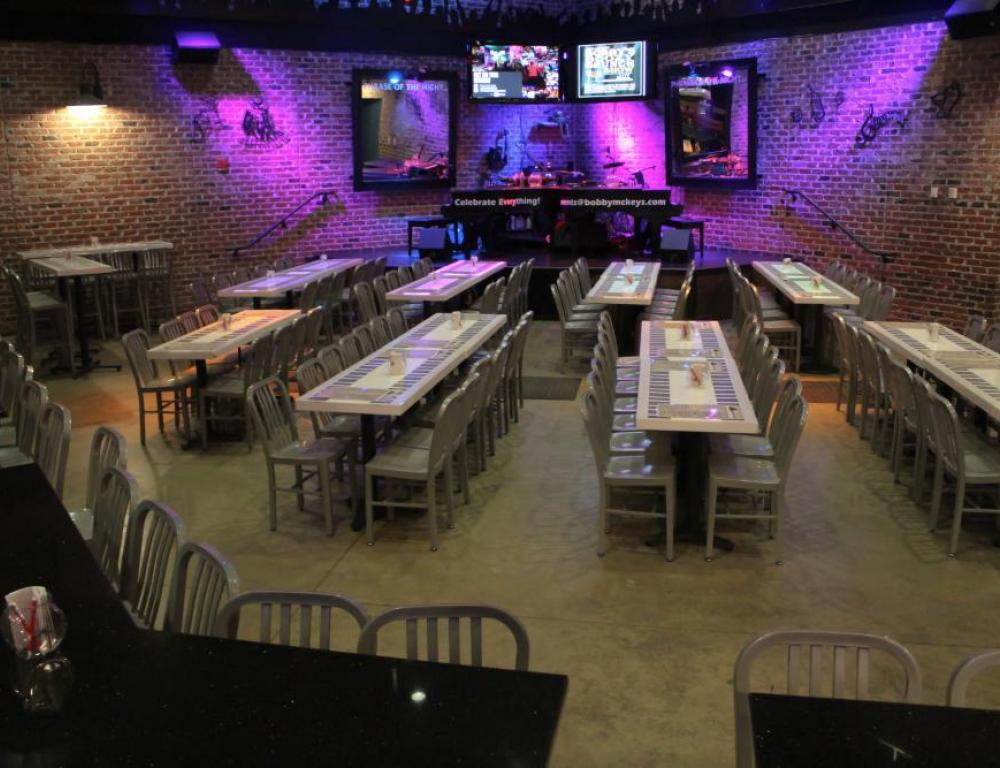 View of main floor event space with stage lighting