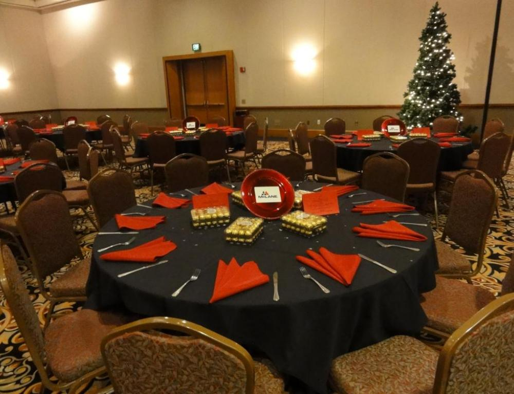 Banquet set with holiday linens and christmas tree