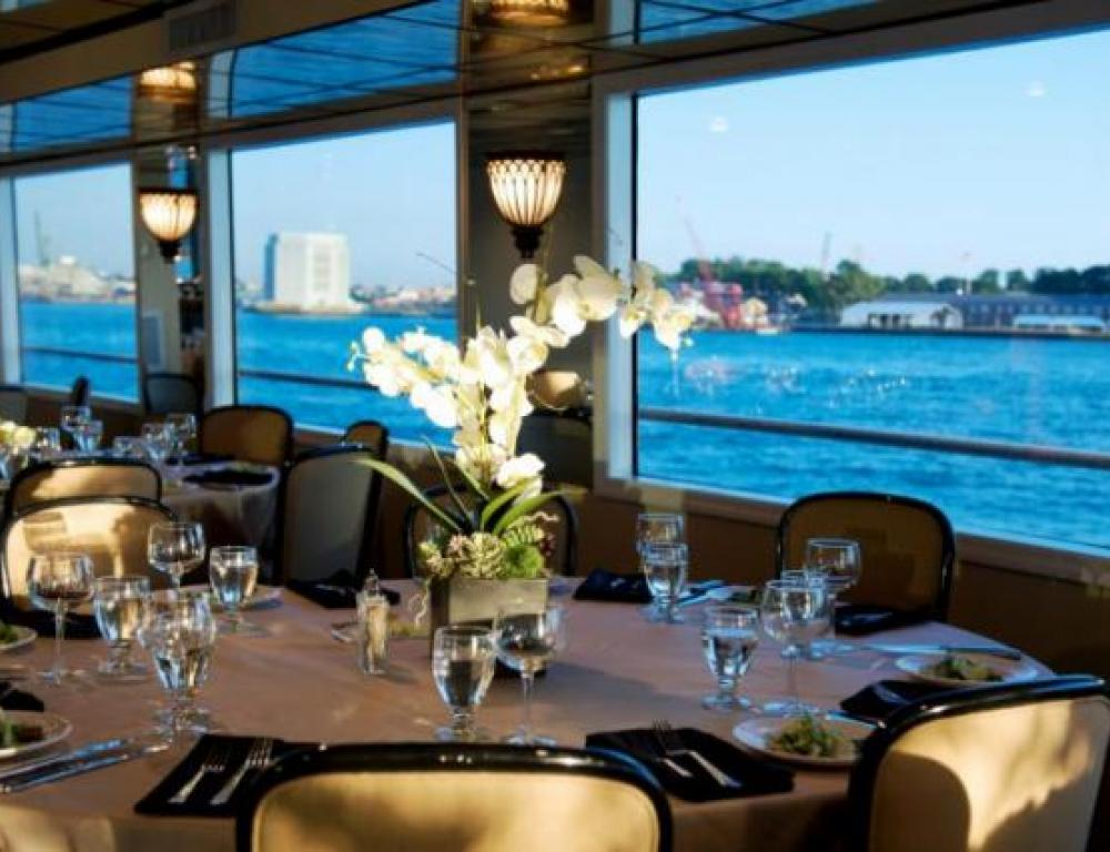 Hudson Harbor Dining Deck with Champagne Linens and Floral Centerpieces Included