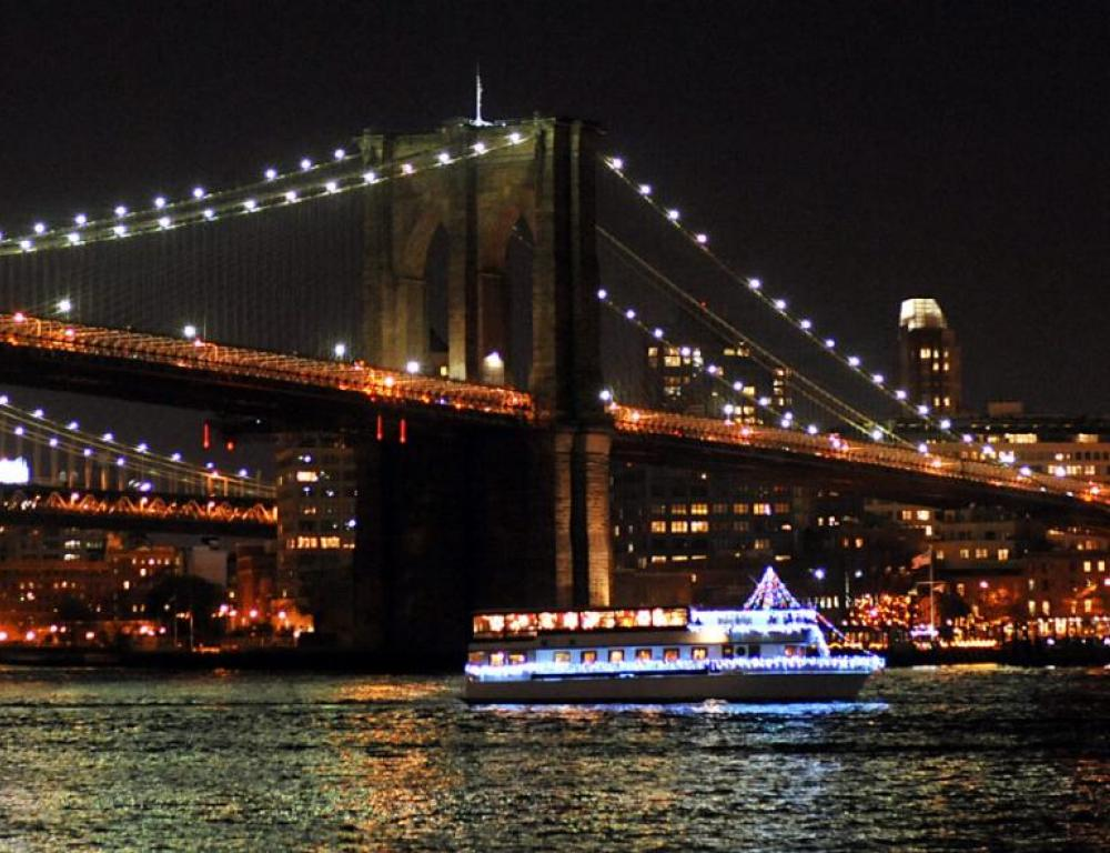 Yacht Sailing Under the Bridges and past the New York City Skyline on the Hudson
