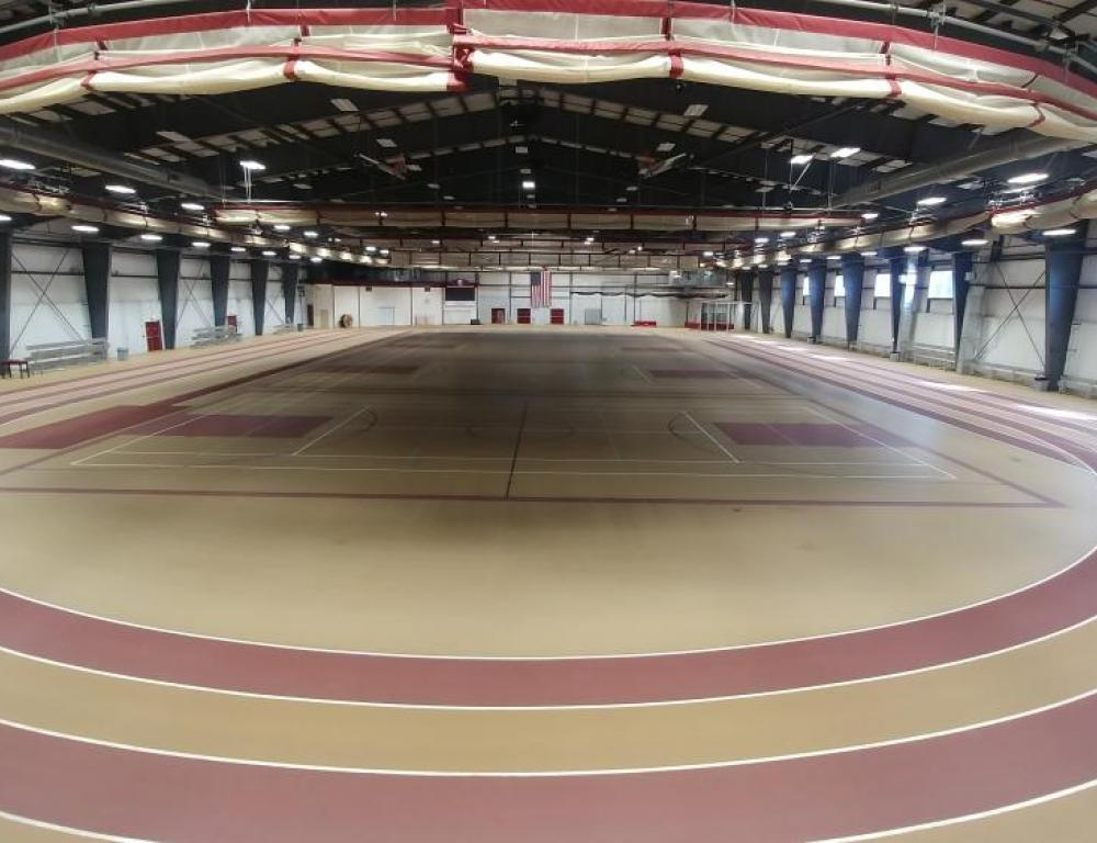 The 98,820 s.f  Field House incorporates a 6 lane running track, 4 multipurpose courts with a netting system that can close off spaces
