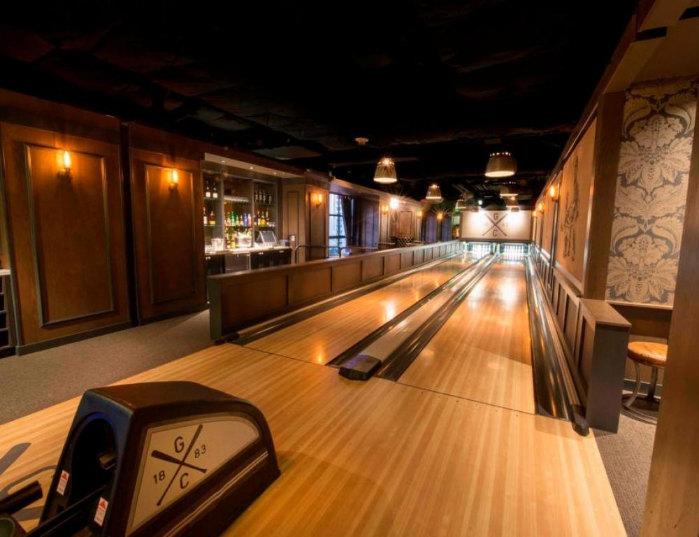Hideaway in your own private bowling alley at the Gotham Game Room
