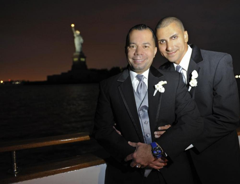 Celebrating Wedding Grooms at Statue of Liberty