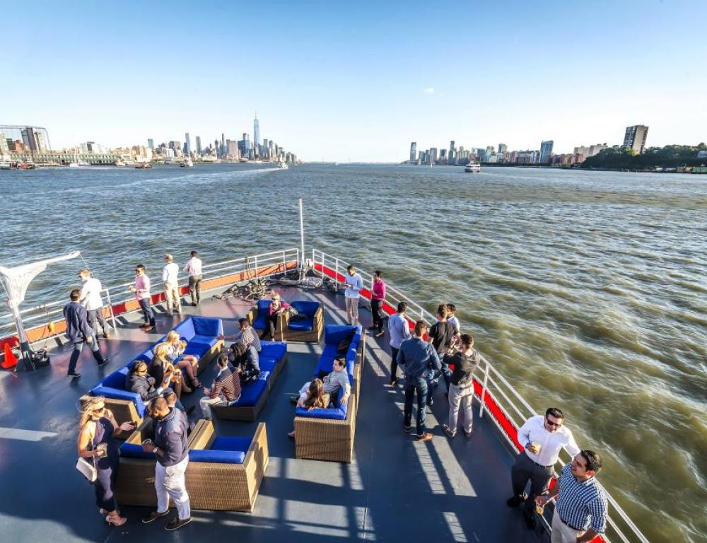 Rooftop networking and bonding while sailing and sightseeing on the Hudson Harbor