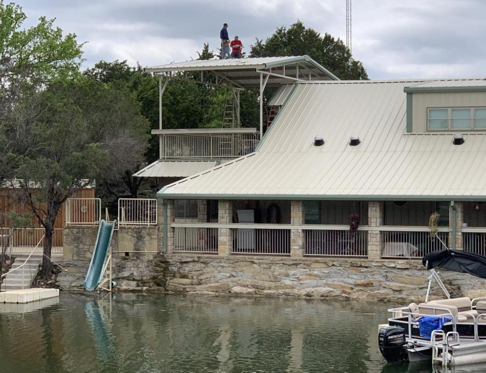 Water slide, upper deck (covered), boat dock and front porch.