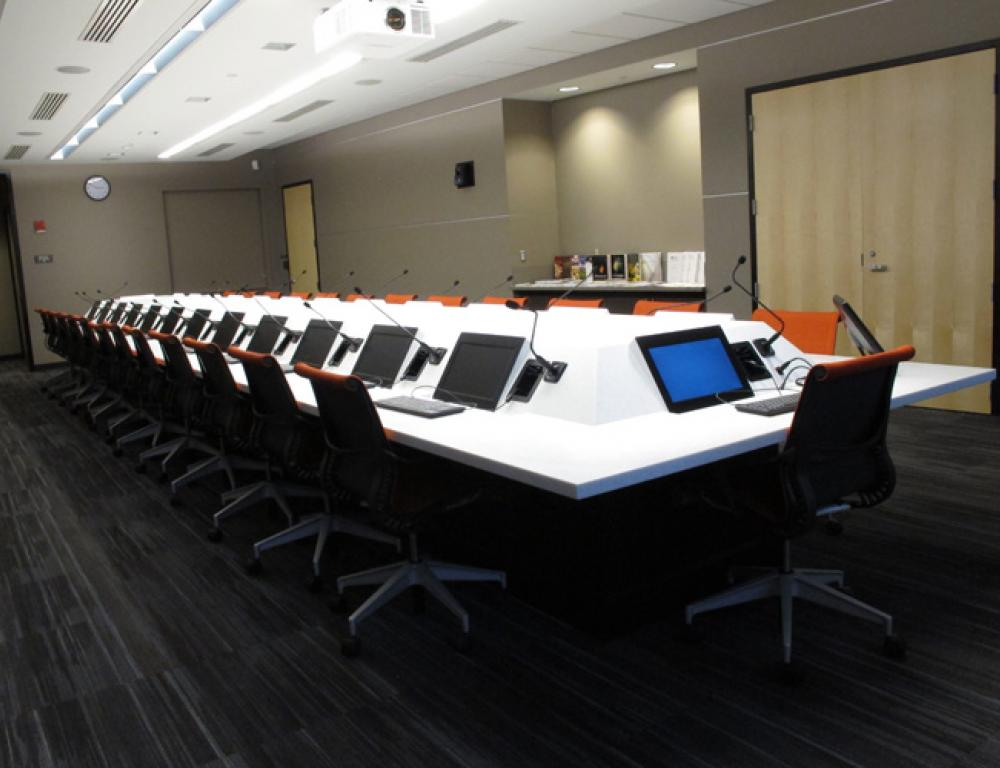 Fixed seating for 26/boardroom style with individual computers and monitors