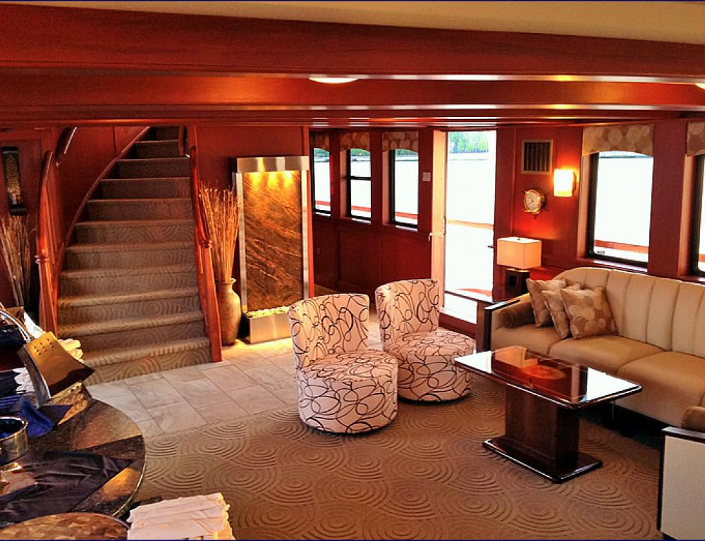 Stairs leading to cocktail lounge & rooftop on a pristine Hudson Harbor yacht