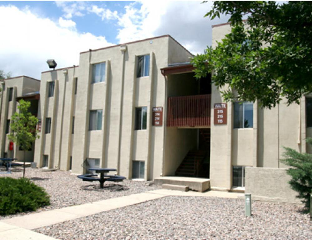 The Stairwell apartments include two bedrooms, one bathroom, a kitchen, and living room space.