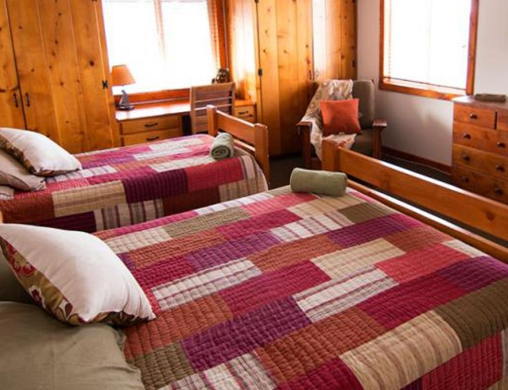 Pali's private rooms are comfortably situated with a traditional cabin aesthetic