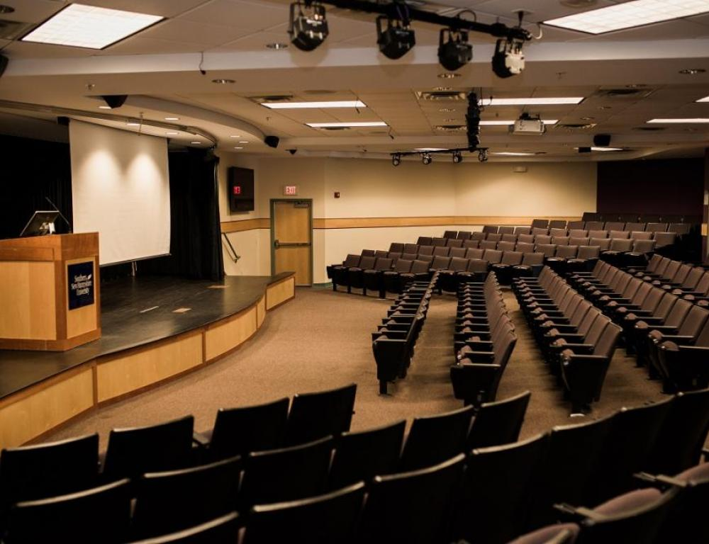 This theater style auditorium accomodates 218 people and is fit with a variety of technological features