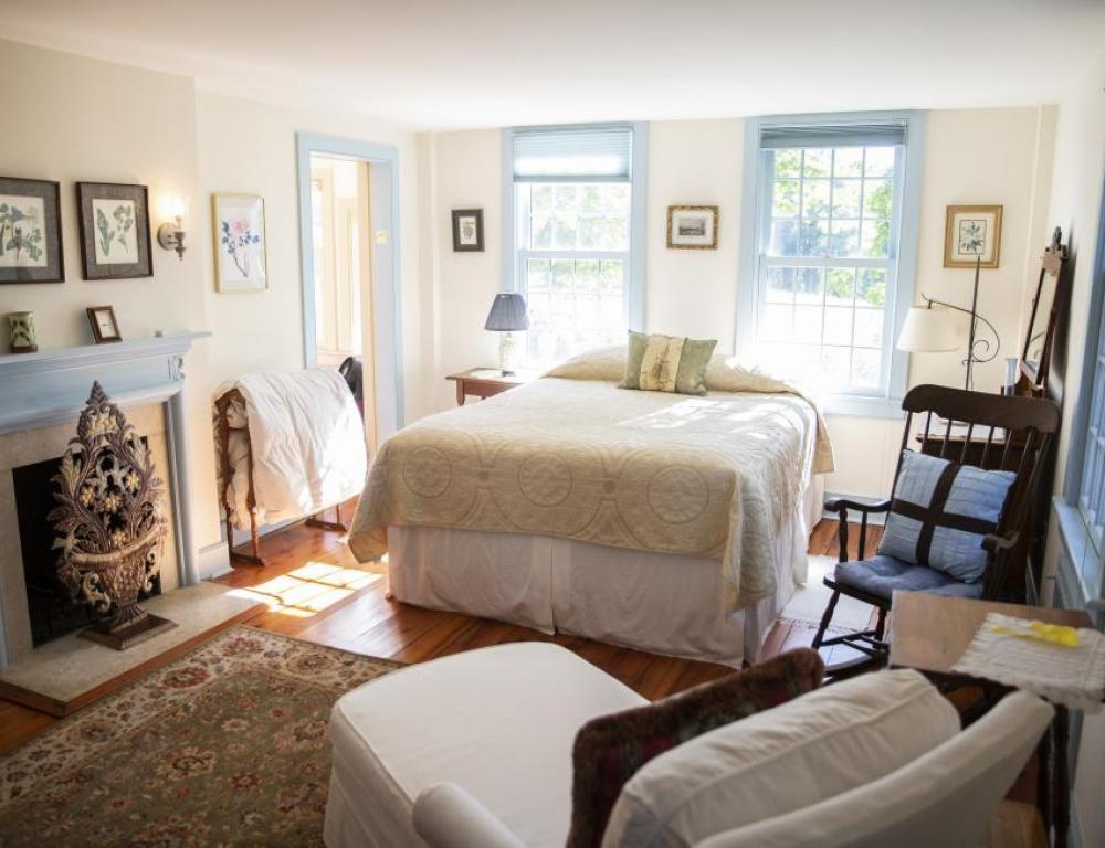 Master bedroom with queen bed and chaise