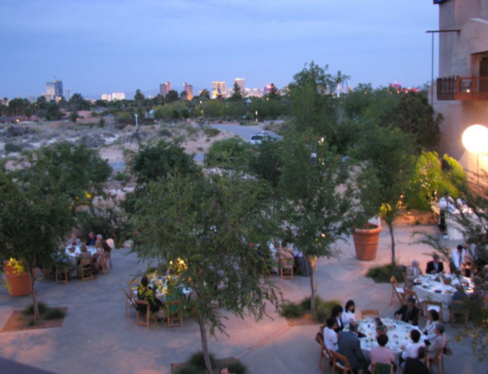 Evening fete in the courtyard plaza with gardens and Las Vegas Strip in background