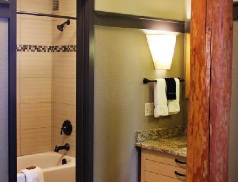 Bathrooms feature granite-top vanities and custom tile