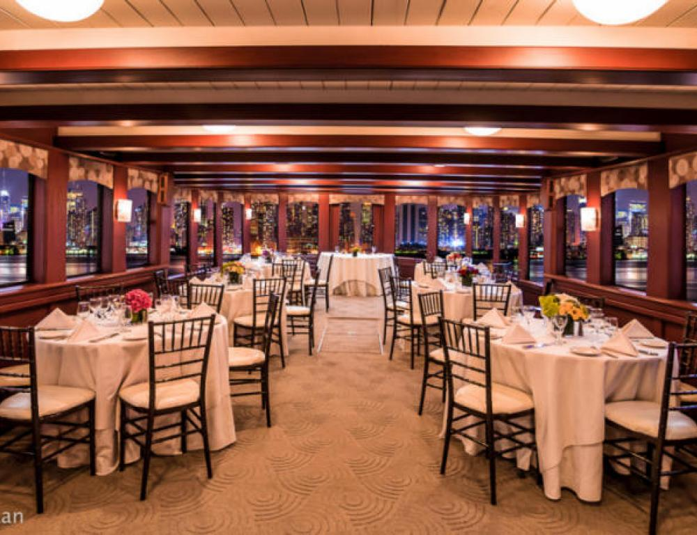 Elegant dining with centerpieces included aboard a Hudson Harbor yacht